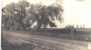 Washington Highway as it looked after grading in 1925 before it was graveled. Photo taken at Lippincott Farm.